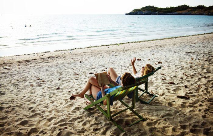reading books on a beach